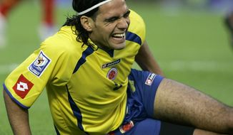 FILE - I this Nov. 17, 2007 file photo, Colombia's Radamel Falcao gestures on the ground after he was injured during a World Cup 2010 qualifying against Venezuela in Bogota, Saturday, Nov. 17, 2007. Falcao was injured this Wednesday, Jan. 22, 2014 during a French Cup game against Chasselay. (AP Photo/Ricardo Mazalan, File)