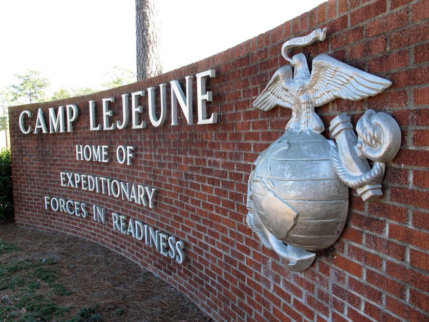 FILE - This March 19, 2013 photo shows the globe and anchor stand at the entrance to Camp Lejeune, N.C. An explosion that killed seven Camp Lejeune Marines during a nighttime training exercise on March 18, 2013, was the result of human error and insufficient training, according to the results of a military investigation. Lt. Adam Flores, a spokesman for the Lejeune-based 2nd Marine Division, said Wednesday, Jan. 22, 2014 that the investigation found the deadly March 18 explosion was triggered when a Marine dropped a second round into an already loaded mortar tube during a live-fire exercise. Two officers and a noncommissioned officer were relieved of command following the explosion at Hawthorne Army Depot in Nevada.  (AP Photo/Allen Breed, File)