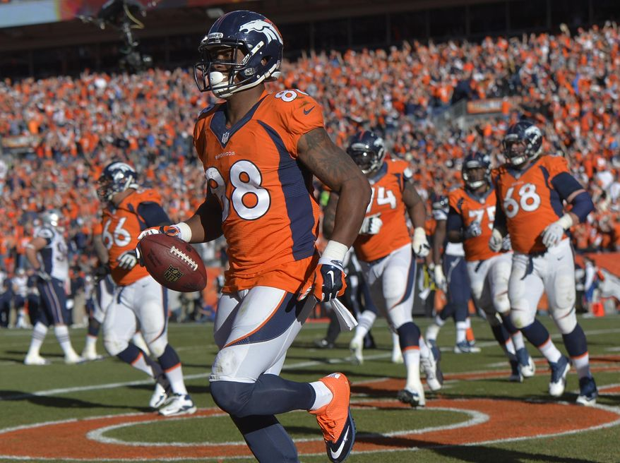 Denver Broncos wide receiver Demaryius Thomas (88) runs off the field with the ball after scoring on a three-yard touchdown pass during the second half of the AFC Championship NFL playoff football game against the New England Patriots in Denver, Sunday, Jan. 19, 2014. (AP Photo/Jack Dempsey)