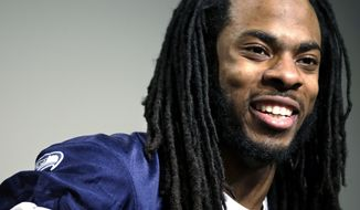 Seattle Seahawks' Richard Sherman speaks during a news conference Wednesday, Jan. 22, 2014, in Renton, Wash. The Seahawks play the Denver Broncos in the NFL football Super Bowl on Feb. 2. (AP Photo/Elaine Thompson)