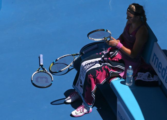 Victoria Azarenka of Belarus sits in a chair during a break in her quarterfinal against Agnieszka Radwanska of Poland at the Australian Open tennis championship in Melbourne, Australia, Wednesday, Jan. 22, 2014.(AP Photo/Eugene Hoshiko)