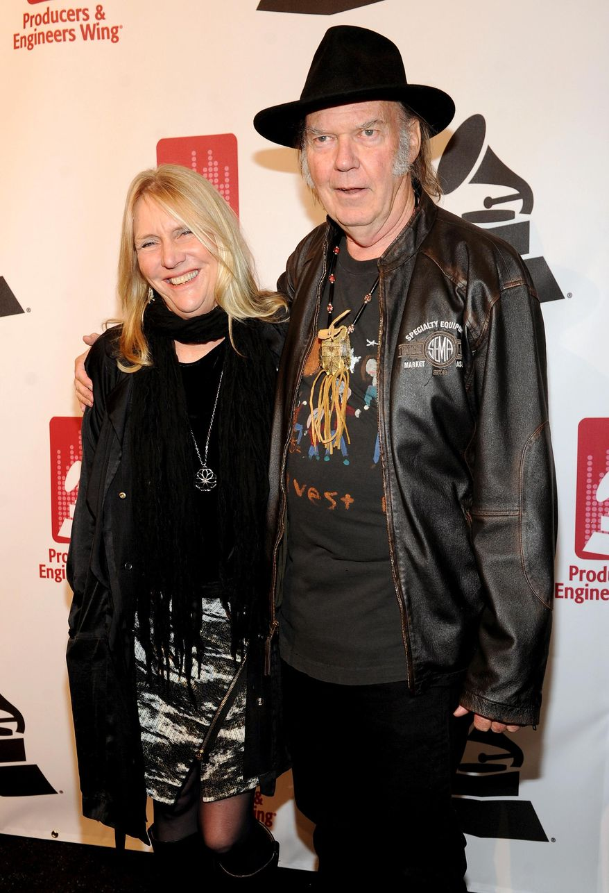 Honoree Neil Young, right, and Pegi Young arrive at the Producers and Engineers of The Academy's 7th Annual Grammy Week Event, at The Village Recording Studios, on Tuesday, Jan. 21, 2014, in Los Angeles. (Photo by Frank Micelotta//AP Images)