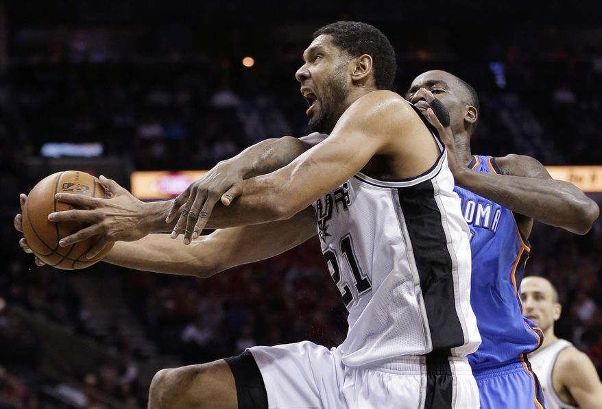San Antonio Spurs' Tim Duncan, left, is fouled by Oklahoma City Thunder's Kendrick Perkins as he tries to score during the first half of an NBA basketball game, Wednesday, Jan. 22, 2014, in San Antonio.  (AP Photo/Eric Gay)