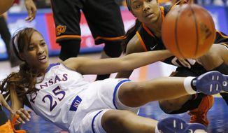 Kansas forward Caelynn Manning-Allen (25) and Oklahoma State guard Roshunda Johnson (00) hit the floor after a loose ball during the second half of an NCAA college basketball game in Lawrence, Kan., Wednesday, Jan. 22, 2014. Oklahoma State defeated Kansas 64-56.(AP Photo/Orlin Wagner)