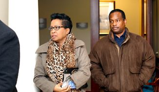 Lisa Cox, 52, and her husband Cleveland, 49, of Liberty Township, arrive for a hearing at Butler County Common Pleas Court Wednesday, Jan. 22, 2014, at the Government Services Center in Hamilton, Ohio, Wednesday, Jan. 22, 2014. The couple is accused of abandoning the adopted 9-year-old son they raised since infancy. (AP Photo/The Journal-News, Nick Daggy)