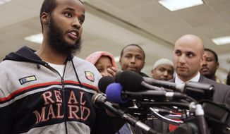 FILE - In this Jan. 21, 2011 file photo, Gulet Mohamed, 19, of Alexandria, Va., left, speaks to the media after returning from Kuwait, at Dulles International Airport in Chantilly, Va. At right is his attorney Gadeir Abbas. A federal judge on Wednesday, Jan. 22, 2014 allowed Mohamed's challenge to his placement on the no-fly list to go forward, three years after he was stranded in Kuwait. (AP Photo/Jacquelyn Martin, File)