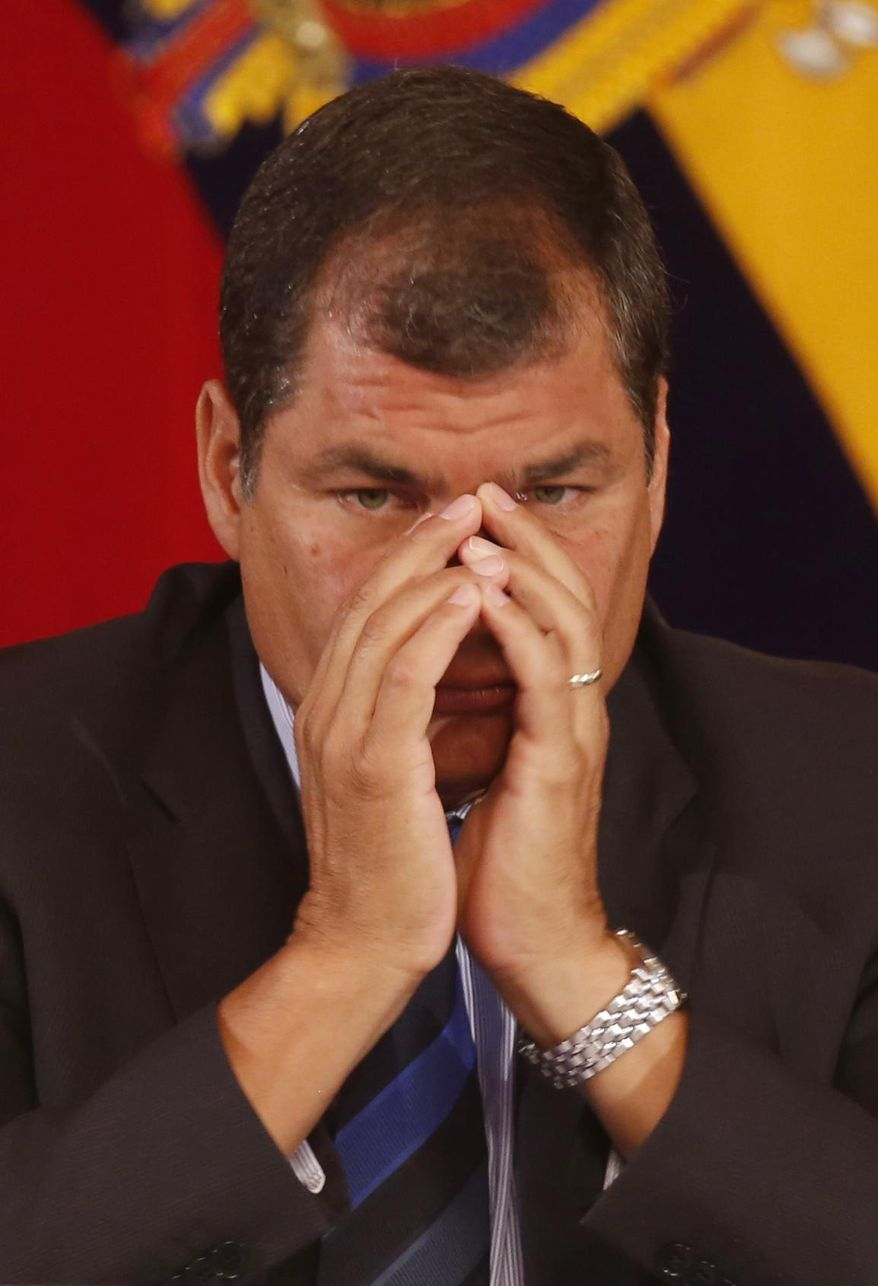 Ecuador's President Rafael Correa gestures as he meets with the foreign press at the government palace in Quito, Ecuador, Wednesday, Jan. 22, 2014. Correa, who was first elected in January 2007, said the U.S. government and his are going through tension and mutual distrust, clarifying that he personally likes the U.S. where he earned two university degrees. (AP Photo/Dolores Ochoa)