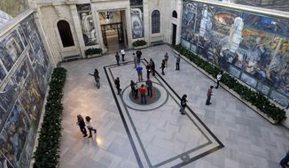 FILE - In Dec. 10, 2013 file photo visitors look at the Detroit Industry Murals by the Diego Rivera at the Detroit Institute of Arts in Detroit. Michigan Gov. Rick Snyder plans to announce Wednesday, Jan. 22, 2014 that he and state legislative leaders are supporting a plan to commit state money that would match $330-plus million in commitments to date from national and local foundations to bolster pension plans and prevent the sale of valuable city-owned art. (AP Photo/Carlos Osorio, File)
