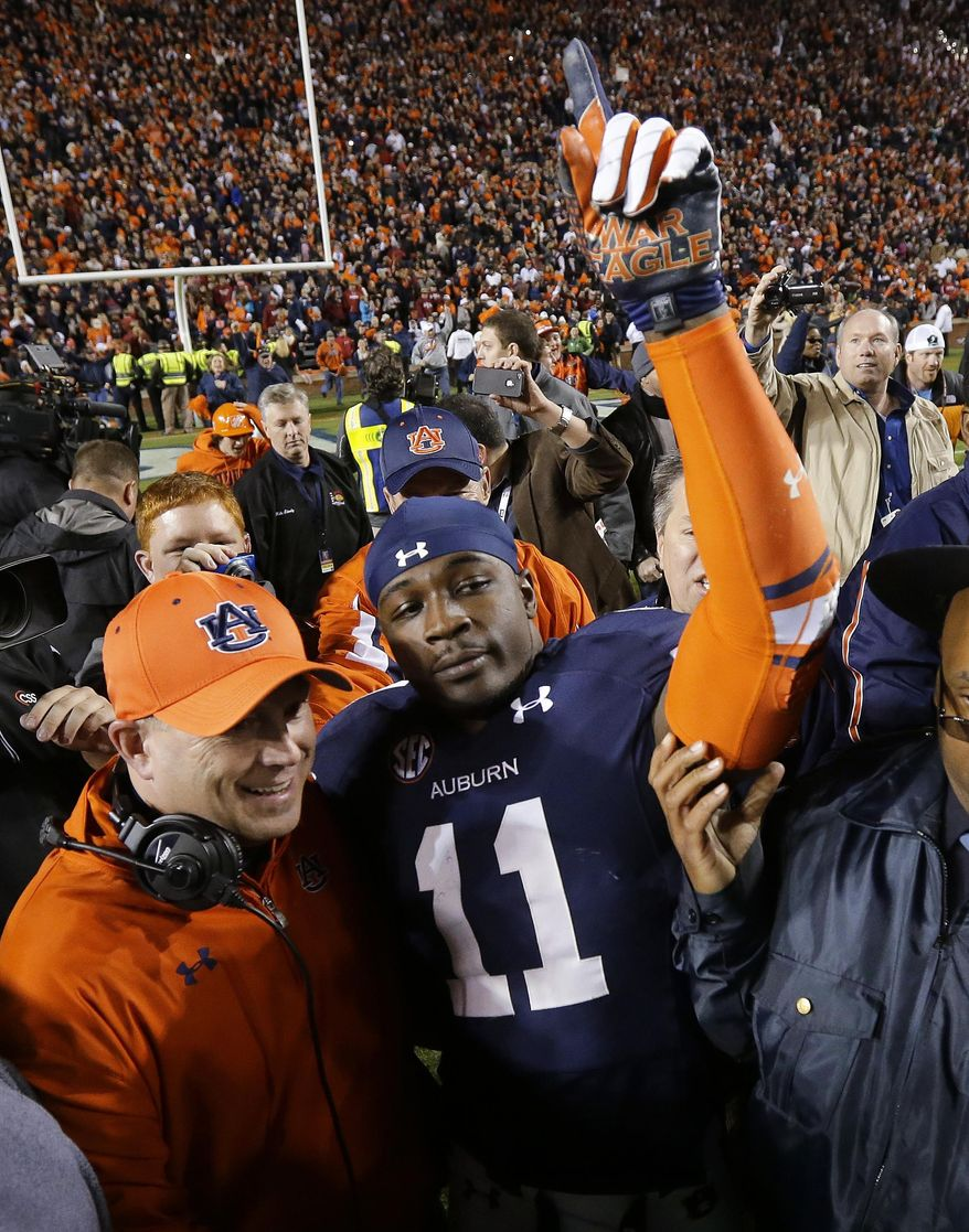 FILE - In this Nov. 30, 2013, file photo, Auburn cornerback Chris Davis (11) reacts after returning a missed field goal attempt 109 yards to score the game-winning touchdown as time expired an NCAA college football game against Alabama in Auburn, Ala. Davis and Dee Ford were much like their Auburn team early in the season, largely floating under the radar. The two defensive players garnered much more attention as the Tigers had success and are trying to forge NFL careers starting with the Senior Bowl. (AP Photo/Dave Martin, File)