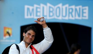Rafael Nadal of Spain walks off the court after defeating Grigor Dimitrov of Bulgaria in their quarterfinal at the Australian Open tennis championship in Melbourne, Australia, Wednesday, Jan. 22, 2014.(AP Photo/Aaron Favila)
