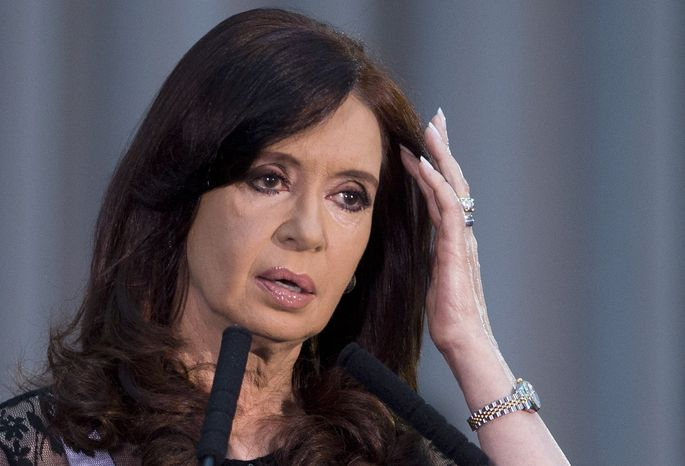 FILE - In this Dec. 10, 2013 file photo, Argentina's President Cristina Fernandez pauses as she speaks at an event marking the 30 year anniversary of the return of democracy in Buenos Aires, Argentina.  After more than one month of silence, Fernandez is scheduled to speak in public on Jan. 22, 2014. The president's silence has fed speculation in Argentina about Fernandez's health since head surgery in October and questions about who is running the country. (AP Photo/Victor R. Caivano, File)