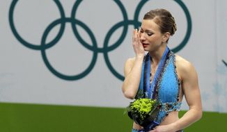 FILE - In this Feb. 25, 2010, file photo, Canada's Joannie Rochette reacts after receiving her bronze medal at the women's figure skating competition at the Vancouver 2010 Olympics in Vancouver, British Columbia. The Canadian figure skater's mother died of a heart attack just before the Vancouver Games. On the eve of the Sochi Games, which Rochette will attend as an analyst for Canadian TV and working with Team Visa, she looks back at 2010 with pride, not sadness, in her voice. (AP Photo/Amy Sancetta, File)