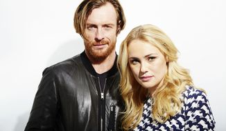 """This Oct. 15, 2013 photo shows Toby Stephens, left, and Hannah New, from the new Starz original series, """"Black Sails,"""" in New York.  The series premieres Saturday, Jan. 25. (Photo by Dan Hallman/Invision/AP)"""
