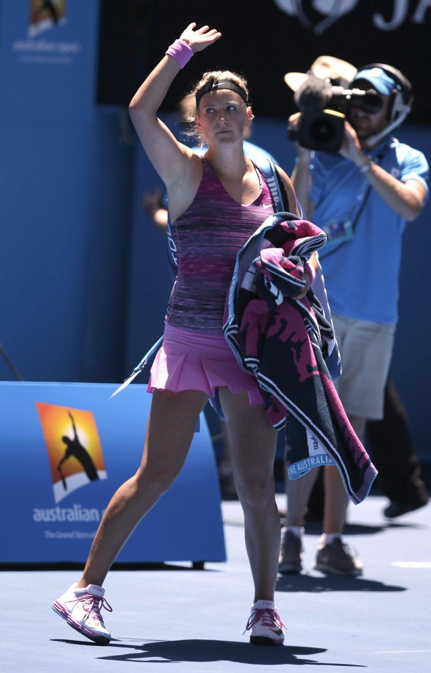 Victoria Azarenka of Belarus walks off the court after her quarterfinal loss to Agnieszka Radwanska of Poland  at the Australian Open tennis championship in Melbourne, Australia, Wednesday, Jan. 22, 2014.(AP Photo/Rick Rycroft)