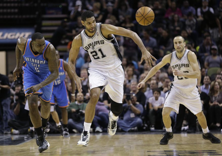 San Antonio Spurs' Tim Duncan (21) steals the ball from Oklahoma City Thunder's Kendrick Perkins (5) during the first half of an NBA basketball game, Wednesday, Jan. 22, 2014, in San Antonio. (AP Photo/Eric Gay)