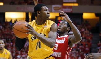 Wichita State forward Cleanthony Early (11) looks for room to pass under pressure tom Illinois State guard Daishon Knight (3) during the first half of an NCAA college basketball game at Redbird Arena, Wednesday, Jan. 22, 2014, in Normal, Ill. (AP Photo/ Stephen Haas)