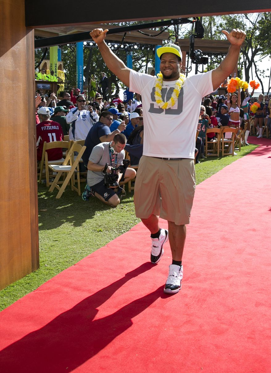 Detroit Lions tackle Ndamukong Suh walks out of the green room into the crowd during the NFL Pro Bowl football draft, Wednesday, Jan. 22, 2014, in Kapolei, Hawaii. (AP Photo/Marco Garcia)