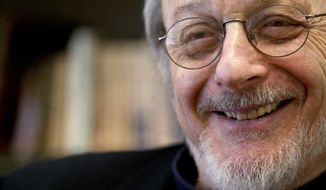 """FILE - In this April 27, 2004 file photo, author E.L. Doctorow smiles during an interview in his office at New York University. Doctorow's latest book, """"Andrew's Brain,""""  takes on the ongoing debates about science vs. literature and humans vs. machines.  (AP Photo/Mary Altaffer, File)"""