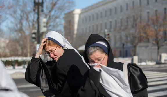 Nuns on their way to support the March for Life endure freezing temperatures in the mid-teens, in Washington, DC., Wednesday, January 22, 2014.  (Andrew S Geraci/The Washington Times)