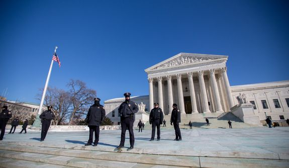 Capitol Police officers stand on guard in front of the Supreme Court during the March For Life, in Washington, DC., Wednesday, January 22, 2014.  (Andrew S Geraci/The Washington Times)