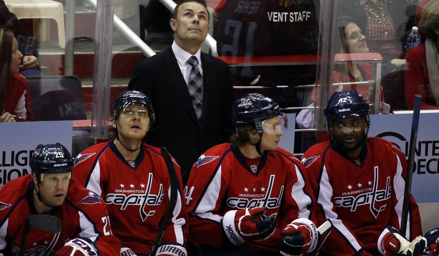 Washington Capitals head coach Adam Oates looks up at the scoreboard, in the third period of an NHL hockey game against the Ottawa Senators, Tuesday, Jan. 21, 2014, in Washington. The Senators won 2-0. (AP Photo/Alex Brandon)