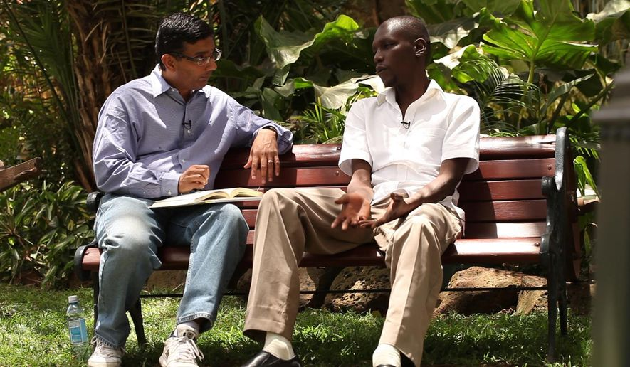 "In this publicity image released by Rocky Mountain Pictures, director Dinesh D'Souza, interviews George Obama in his film, ""2016: Obama's America."" (AP Photo/Rocky Mountain Pictures, File)"