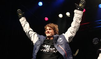 Nick Goepper celebrates after being announced to the U.S. Olympic freeskiing team following the U.S. Grand Prix Saturday, Jan. 18, 2014, in Park City, Utah. (AP Photo/Rick Bowmer)