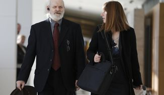FILE - In this Nov. 15, 2013 file photo, Wayne Sperling, left, arrives at court with his public defender, at the Denver Justice Center, in Denver. Sperling and his partner Lorinda Bailey, who are charged with keeping their four young boys in a filthy Denver apartment, both pleaded not guilty to felony child abuse charges on Thursday, Jan. 23, 2014. (AP Photo/Brennan Linsley, File)
