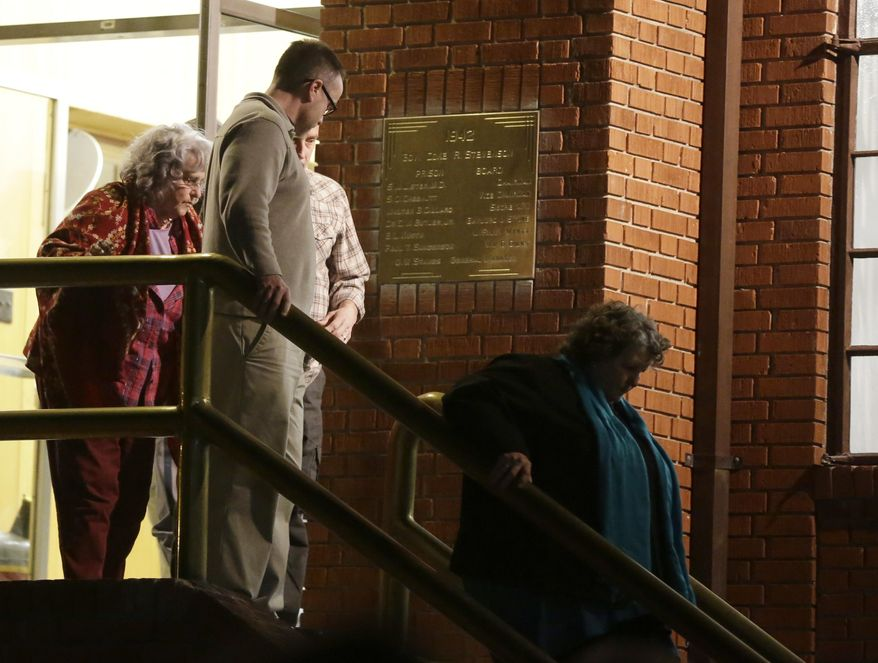 The family of slain Houston police officer Guy Gaddis leave the prison after witnessing the execution of Mexican national Edgar Tamayo Wednesday, Jan. 22, 2014, in Huntsville, Texas. Tamayo was convicted of killing Gaddis 20 years ago. (AP Photo/Pat Sullivan)
