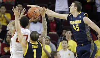Southern California's J.T. Terrell, left, gets his shot blocked by California's David Kravish during the first half of an NCAA college basketball game on Wednesday, Jan. 22, 2014, in Los Angeles. (AP Photo/Jae C. Hong)