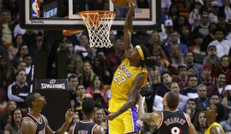 Los Angeles Lakers forward Jordan Hill (27) goes to the basket against the Miami Heat during the second quarter of an NBA basketball game in Miami, Thursday, Jan. 23, 2014. (AP Photo/Alan Diaz)