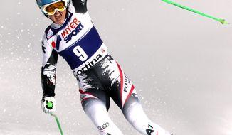 Austria's Elisabeth Goergl celebrates in the finish area after winning an alpine ski, women's World Cup super-g, in Cortina d'Ampezzo, Italy, Thursday, Jan. 23, 2014. (AP Photo/Armando Trovati)