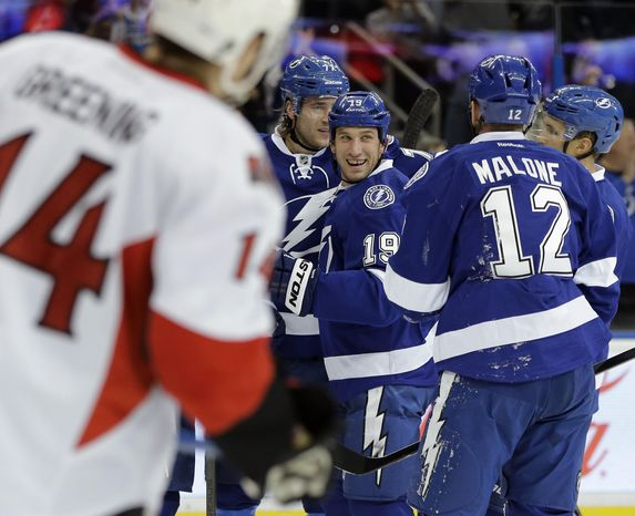 Tampa Bay Lightning right wing B.J. Crombeen (19) celebrates his goal against the Ottawa Senators with teammates, including Ryan Malone (12) during the second period of an NHL hockey game Thursday, Jan. 23, 2014, in Tampa, Fla. (AP Photo/Chris O'Meara)