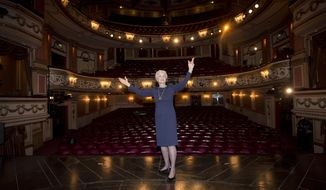 British actress and singer Dame Angela Lansbury is photographed on stage at the Gielgud Theatre in central London, as she returns to the West End this spring for the first time in nearly 40 years, with the play, Blithe Spirit, by Noel Coward, Thursday, Jan. 23, 2014. Lansbury reunites with director Michael Blakemore to reprise her role as Madame Arcati. (Photo by Joel Ryan/Invision/AP)