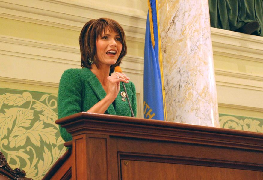 Rep. Kristi Noem, R-S.D., speaks Wednesday, Jan. 22, 2014, in Pierre, S.D., to the South Dakota Senate. Noem, who was in the South Dakota House before being elected to Congress, says it's fun to visit South Dakota because state government gets things done much better than Congress does. (AP Photo/Chet Brokaw)
