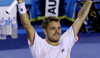 Stanislas Wawrinka of Switzerland celebrates after defeating Tomas Berdych of the Czech Republic during their semifinal at the Australian Open tennis championship in Melbourne, Australia, Thursday, Jan. 23, 2014. (AP Photo/Aijaz Rahi)