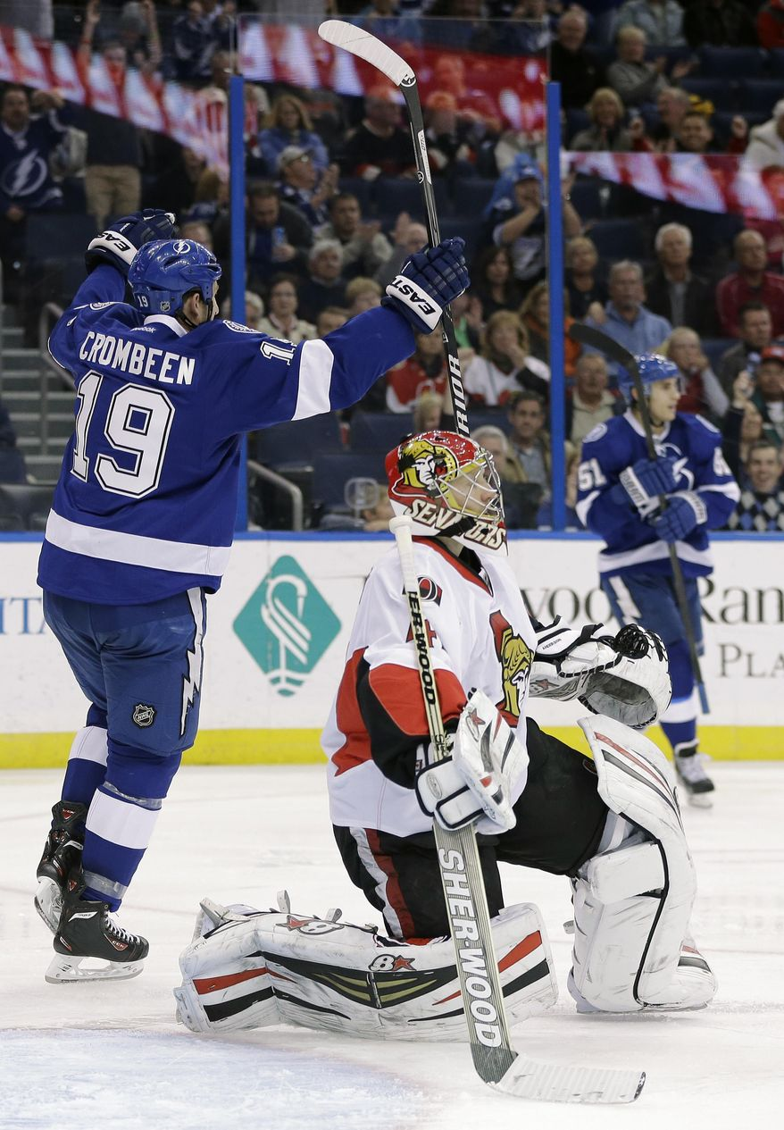 Tampa Bay Lightning right wing B.J. Crombeen (19) celebrates after scoring past Ottawa Senators goalie Craig Anderson (41) during the second period of an NHL hockey game Thursday, Jan. 23, 2014, in Tampa, Fla. (AP Photo/Chris O'Meara)