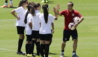 "United States' Landon Donovan high fives young players who will attend a program coined ""Sports for All', organized by the US consulate to give public school kids soccer and English lessons, in Sao Paulo, Brazil, Wednesday, Jan. 22, 2014. The US national soccer team is training in Sao Paulo to prepare for the World Cup tournament, which gets underway in June.  (AP Photo/Nelson Antoine)"