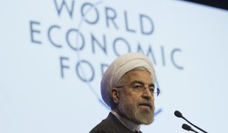 Iranian President Hassan Rouhani, speaks during a session of the World Economic Forum in Davos, Switzerland, Thursday, Jan. 23, 2014. Leaders gathered in the Swiss ski resort of Davos have made it a top priority to push to reshape the global economy and cut global warming by shifting to cleaner energy sources. (AP Photo/Michel Euler)