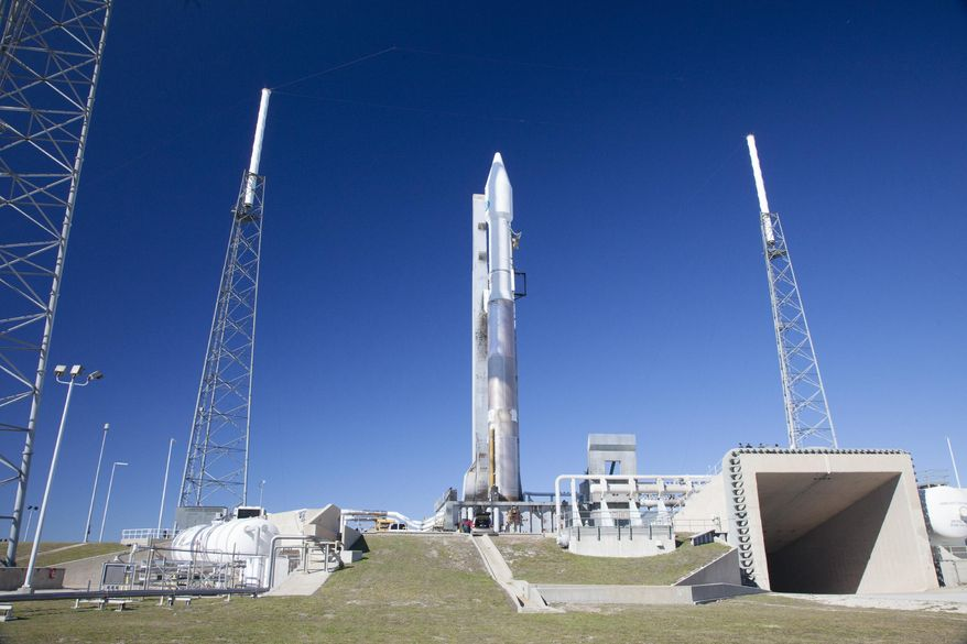 In this photo provided by NASA, NASA's Tracking and Data Relay Satellite, or TDRS-L, spacecraft arrives atop a United Launch Alliance Atlas V at the launch pad Wednesday Jan. 22, 2014. Liftoff is targeted for the opening of a 40-minute launch window at 9:05 p.m. EST Thursday, Jan. 23.  (AP Photo/NASA)