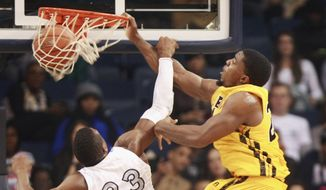 Southern Mississippi's Michael Craig, right, dunks against Old Dominion's Richard Ross during the first half of an NCAA college basketball game Thursday, Jan. 23, 2014, in Norfolk, Va. (AP Photo/The Virginia-Pilot, L. Todd Spencer) MAGS OUT