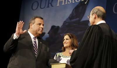 "As wife Mary Pat Christie holds the Bible, New Jersey Gov. Chris Christie is sworn in for his second term by New Jersey Supreme Court Chief Justice Stuart Rabner, right,  Tuesday, Jan. 21, 2014, in Trenton, N.J.  Mired in a scandal,  Christie sought to turn back the clock Tuesday and focus on the mandate he said he got in November to ""stay the course"" and put aside differences, even as Democrats ramped up an investigation into whether his administration abused its power.  (AP Photo/Mel Evans)"