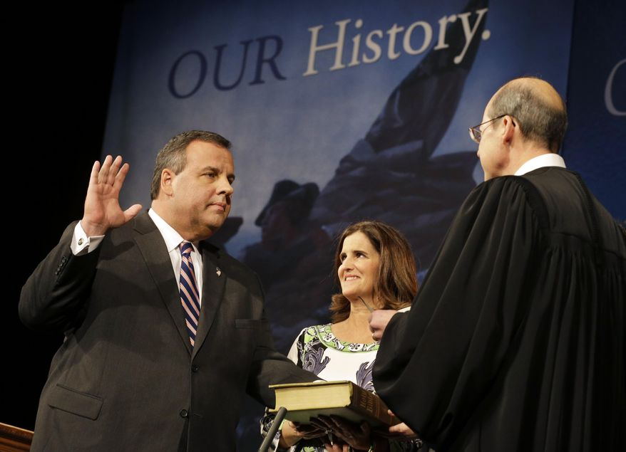 """As wife Mary Pat Christie holds the Bible, New Jersey Gov. Chris Christie is sworn in for his second term by New Jersey Supreme Court Chief Justice Stuart Rabner, right,  Tuesday, Jan. 21, 2014, in Trenton, N.J.  Mired in a scandal,  Christie sought to turn back the clock Tuesday and focus on the mandate he said he got in November to """"stay the course"""" and put aside differences, even as Democrats ramped up an investigation into whether his administration abused its power.  (AP Photo/Mel Evans)"""