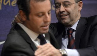FC Barcelona's President Sandro Rosell, left, hugs to Vice-president Josep Maria Bartomeu, after a press conference at the Camp Nou stadium in Barcelona, Spain, Thursday, Jan 23, 2014. Sandro Rosell is stepping down as president of Barcelona a day after a judge agreed to hear a lawsuit accusing him of allegedly hiding the cost of the transfer of Brazil striker Neymar.Rosell says he is resigning after an emergency meeting with Barcelona's board of directors on Thursday. Rosell says vice president Josep Bartomeu will take his place as president and finish the term that expires in 2016. Elected in 2010 to replace outgoing president Joan Laporta, Rosell said last April he planned to run for re-election in 2016. (AP Photo/Manu Fernandez)