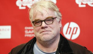 "FILE - In this Sunday, Jan. 19, 2014 file photo, cast member Philip Seymour Hoffman poses at the premiere of the film ""A Most Wanted Man"" during the 2014 Sundance Film Festival, in Park City, Utah.  Hoffman's new movie is a psychological thriller about terrorism, but he says it also has something to do with hitting a midlife crisis, and that's what really drew him to the role. He plays a German operative heading up an anti-terrorism team in Hamburg, Germany. (Photo by Danny Moloshok/Invision/AP, File)"