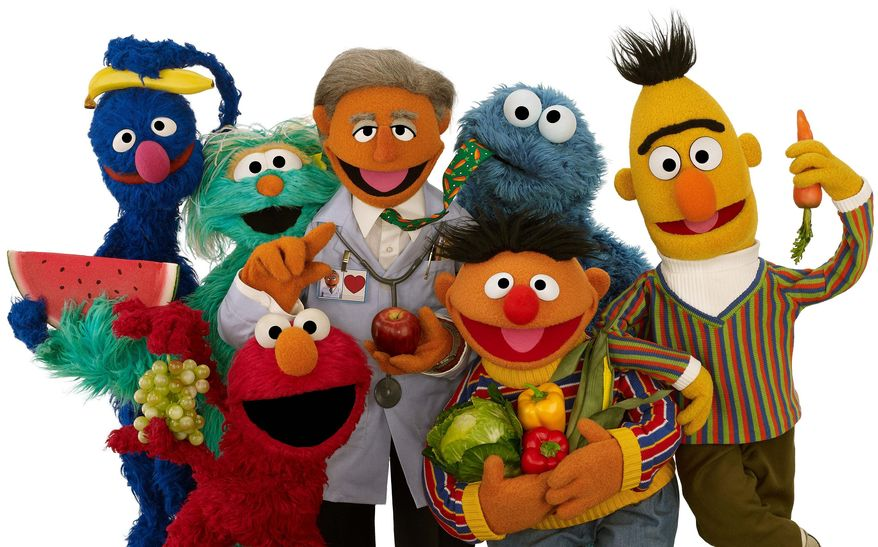 This April 10, 2012 photo provided by Sesame Workshop shows new Muppet Dr. Ruster, center, with, from left, Grover, Rosita, Elmo, Cookie Monster, Ernie and Bert. Dr. Valentin Fuster, a cardiologist at New York's Mount Sinai Hospital who Dr. Ruster is based on, teamed up with Sesame Street on a project to improve kids' health, and it has shown progress in a study in Colombia. In 2014, the project is planned to launch in New York in what sponsors hope will be a first step to fight childhood obesity nationwide. (AP Photo/Sesame Workshop, John Barrett)