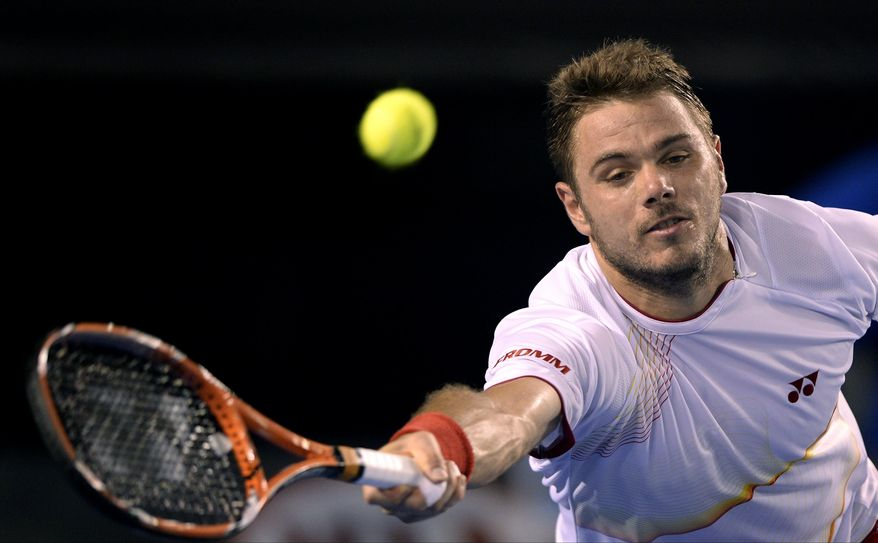 Stanislas Wawrinka of Switzerland makes a forehand return to Tomas Berdych of the Czech Republic during their semifinal at the Australian Open tennis championship in Melbourne, Australia, Thursday, Jan. 23, 2014.(AP Photo/Andrew Brownbill)