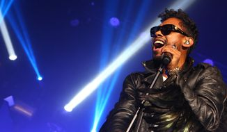 This Jan. 22, 2014 photo shows Miguel performing in Los Angeles. (Photo by Alexandra Wyman/Invision/AP)