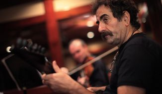 **FILE** Iranian musician Shahram Nazeri rehearses for a Los Angeles concert in Beverly Hills, Calif., on Oct. 1, 2009. (Associated Press)
