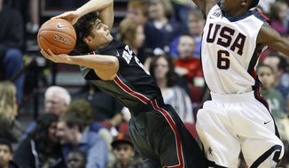 The U.S. Junior National Team's Bradley Beal (8), of St. Louis, Mo., defends as the World Team's Raul Togni Neto, of Brazil, passes the ball in the second half during the Nike Hoop Summit basketball game Saturday, April 9, 2011, in Portland, Ore.(AP Photo/Rick Bowmer)